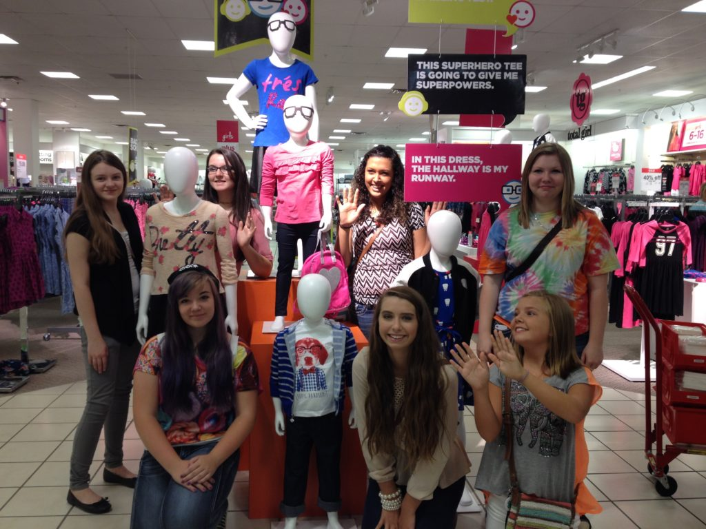 Local 4-H'ers posing with mannequins at J.C Penny During educational tour.